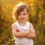 portrait of a boy in white t-shire surrounder yellow flowers, children family portrait photographer Nottingham, Derby, Eastwood,